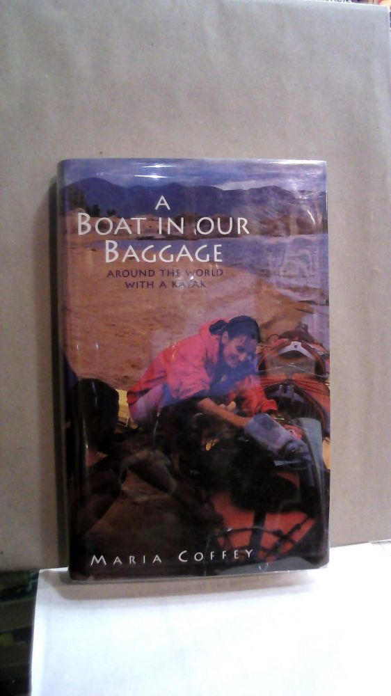 A Boat in Our Baggage : Around the World with a Kayak. Maria Coffey.