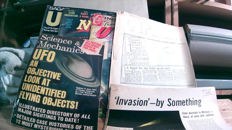 """Collection of UFO printed material. Science & Mechanics Vol. 37 No. 12 December 1966; Space Adventures Presents U.F.O.; Mad Magazine No. 200 July 1978; Saga's UFO Special Vol. III (3); Life Magazine April 1, 1966 """"'Invasion' - By Something"""" article; Photocopied Flying Saucer Review Vol. 18 No. 5 September-October 1972."""