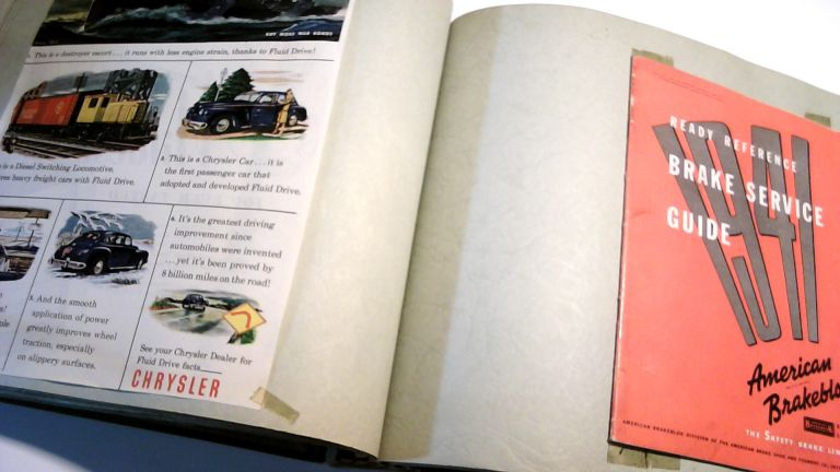 """Collection of 1940s Car Advertisements and Pamphlets, Including """"The Automobile User's Guide With War Time Suggestions 5th Printing Revises,"""" """"AAA Kem'em Rolling,"""" and """"Ready Reference Brake Service Guide 1941"""" in Photobook"""