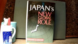 JAPAN'S NEW GLOBAL ROLE. Edward J. LINCOLN
