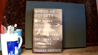 LORDS OF POVERTY: The Power, Prestige, and Corruption of the International Aid Business. Graham...